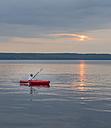 Sweden, Vastra Gotaland County, Tiveden National Park, Lake Skagern, kayaking boy - JBF000215