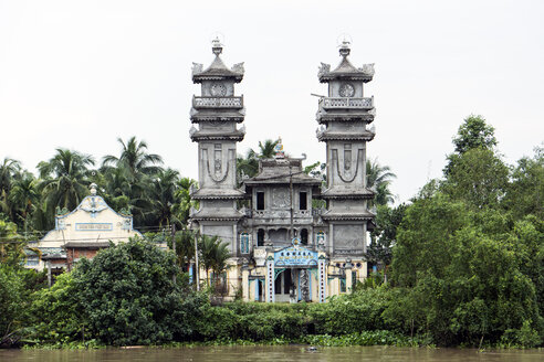 Vietnam, Nam Bo, Can Tho, view to church of denomination Cao Dai at waterside of a canal - WEF000263