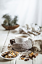 Bowl of Masala chai with almond milk on jute and wood - SBDF001479