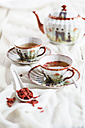 Two Japaense cups of green tea with dried Goji berries, Lycium barbarum - SBDF001493