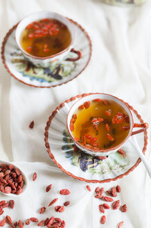 Two cups of green jasmine tea with dried Goji berries, Lycium barbarum - SBDF001495