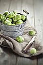 Peeled brussel sprouts in tin bucket, knife, studio - SBDF001444