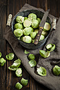 Peeled brussel sprouts in tin bucket, knife, studio - SBDF001449