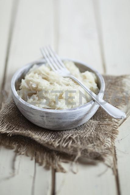 Sauerkraut in wooden bowl with fork, studio - SBDF001450