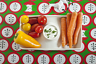 Baby-sized vegetables, carrots, tomatoes, bell pepper with sour-cream-dip, toy horse, studio - SBDF001461