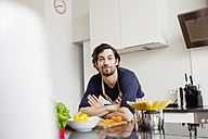 Portrait of smiling man in kitchen - FMKF001402
