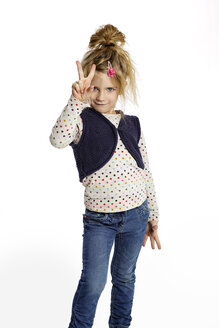 Blond little girl showing victory sign in front of white background - GDF000625