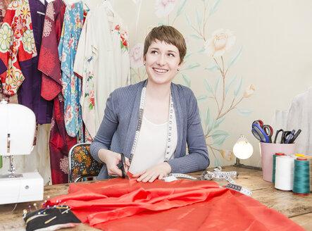 Portrait of female fashion designer at her desk - DISF001149