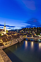 Switzerland, Bern, cityscape with Untertorbruecke, Nydeggkirche and River Aare in the evening - WDF002752