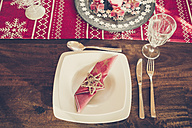 Place setting with Christmas decoration laid dining table - SARF001103
