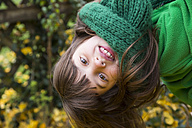 Portrait of smiling girl wearing green scarf - LVF002412