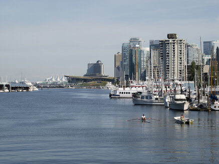 Canada, British Columbia, Vancouver, Marina with boats in front of skyscrapers - HLF000793