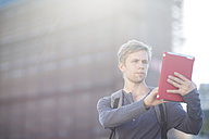 Young man using digital tablet in the city - ZEF001544