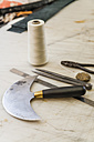 Tools on working surface in saddlery - TCF004337