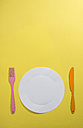 Food concept with paper, plate, fork and knife on yellow background - DEGF000017