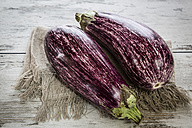Two organic aubergines on cloth - SARF001129