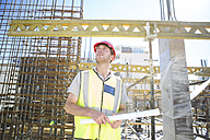 Construction worker looking at construction site - ZEF001950