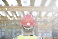 Construction worker wearing hard hat on construction site - ZEF001645