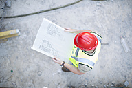 Construction worker reading plan at construction site - ZEF001648