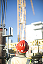 Construction worker wearing hard hat on construction site - ZEF001661
