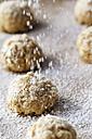 Sprinkling flapjacks with icing sugar - EVGF001387