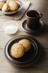 Cup of tea and plate with scones - EVGF001393