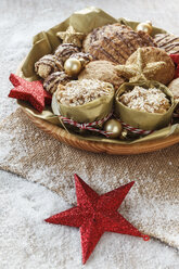 Bowl of different oat pastries and Christmas decoration - EVGF001395