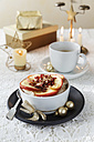 Bowl of porridge with roasted apple at Christmas time - EVGF001398