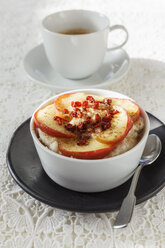Bowl of porridge with roasted apple and cup of coffee - EVGF001399