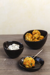 Bowls of vegetarian oat fritters and dip - EVGF001403