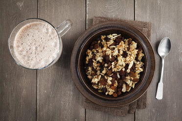 Plate of homemade granola and glass of cocoa - EVGF001407