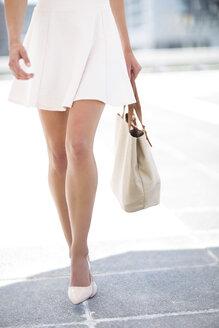 White dressed woman with handbag - ZEF002110