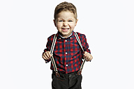 Little boy wearing suspenders pouting mouth - GDF000631