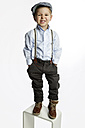 Little boy wearing cap and suspenders pouting mouth - GDF000634