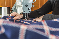 Close-up of woman sewing with a sewing machine - DEGF000026