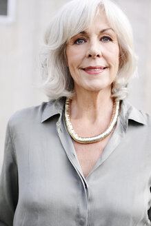 Portrait of smiling white haired senior woman wearing blouse and necklace - VRF000123