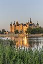 Germany, Mecklenburg-Vorpommern, Schwerin, Schwerin Castle at dusk - PVCF000250