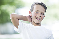 Portrait of smiling boy with hand behind his head - ZEF002745