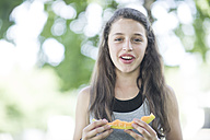 Portrait of girl eating a melon - ZEF002766