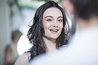 Smiling young woman in a conversation - ZEF003435
