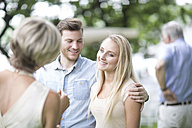 Young couple at family gathering - ZEF003455