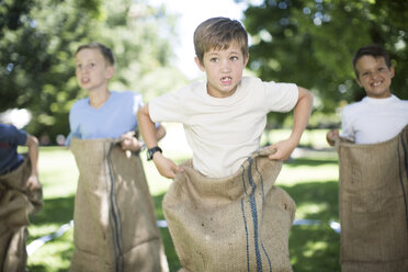 Boys competing in a sack race - ZEF002794