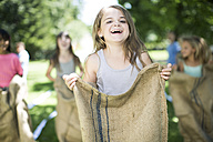 Girl competing in a sack race - ZEF002798