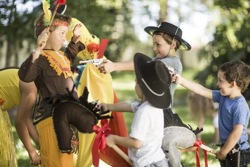 Kids in garden playing Cowboys and Indians - ZEF002800