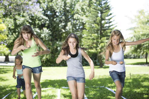 Girls competing in an egg-and-spoon race - ZEF002814