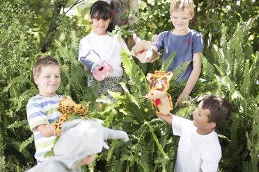 Kids playing wild animal dress-up - ZEF002818