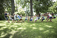 Boys and girls competing in tug of war - ZEF002825