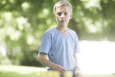 Portrait of blond boy in garden - ZEF002833