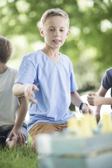 Boys in garden playing quoits - ZEF003234