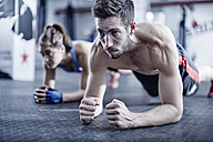 Man and woman doing fitness training - ZEF002626